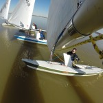 View from end of the boom of Laser sailing downwind